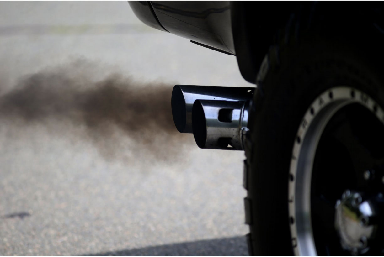 Exhaust pipe on car causing harmful emissions